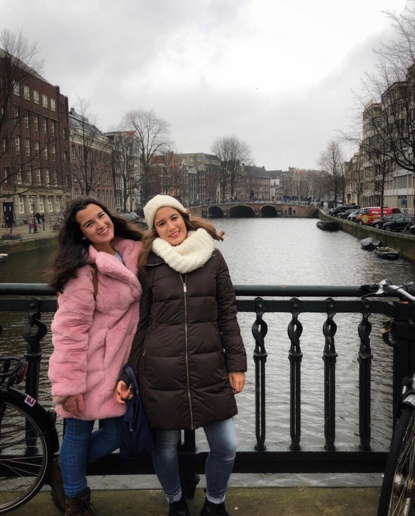 Two girls in winter coats in Amsterdam, Netherlands