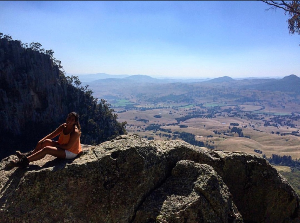 Girl hiking on the top of a mountain in Brisbane, Australia