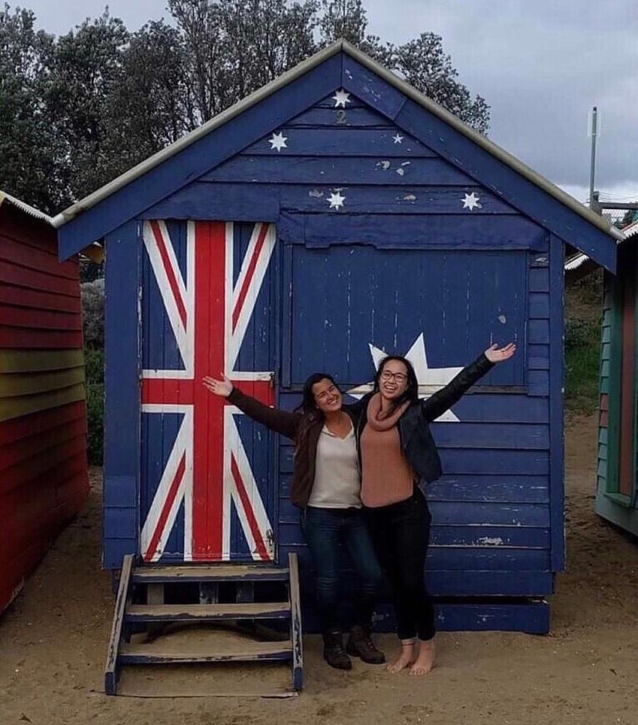 Two girls at Brighton Beach huts, Melbourne, Australia