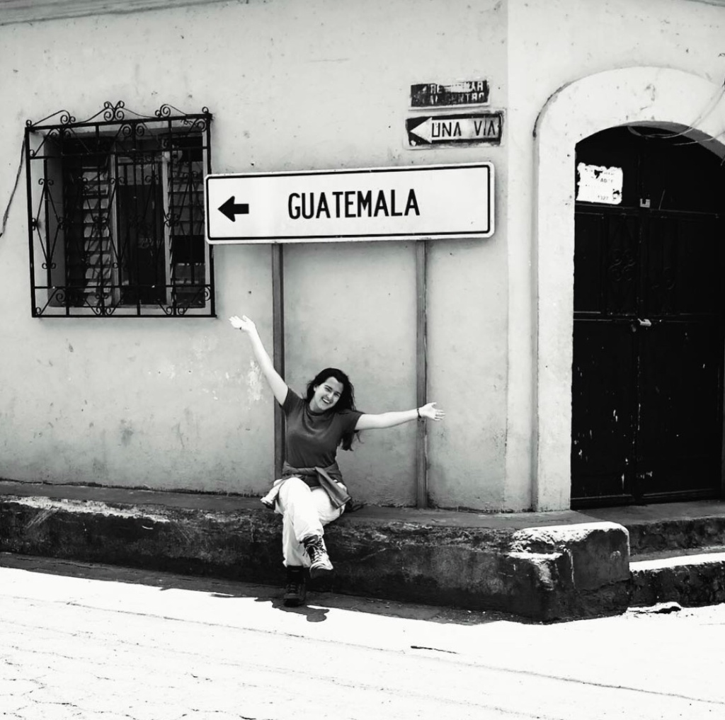 Girl under the street sign in Guatemala