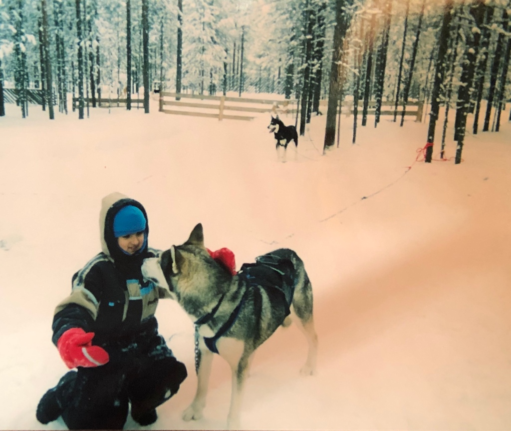 Girl with a husky  in Lapland, Finland