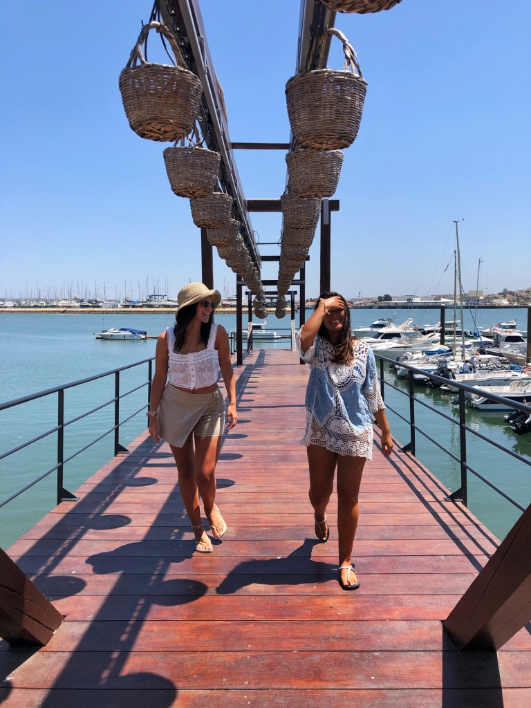 Two girls in the docks. By the sea