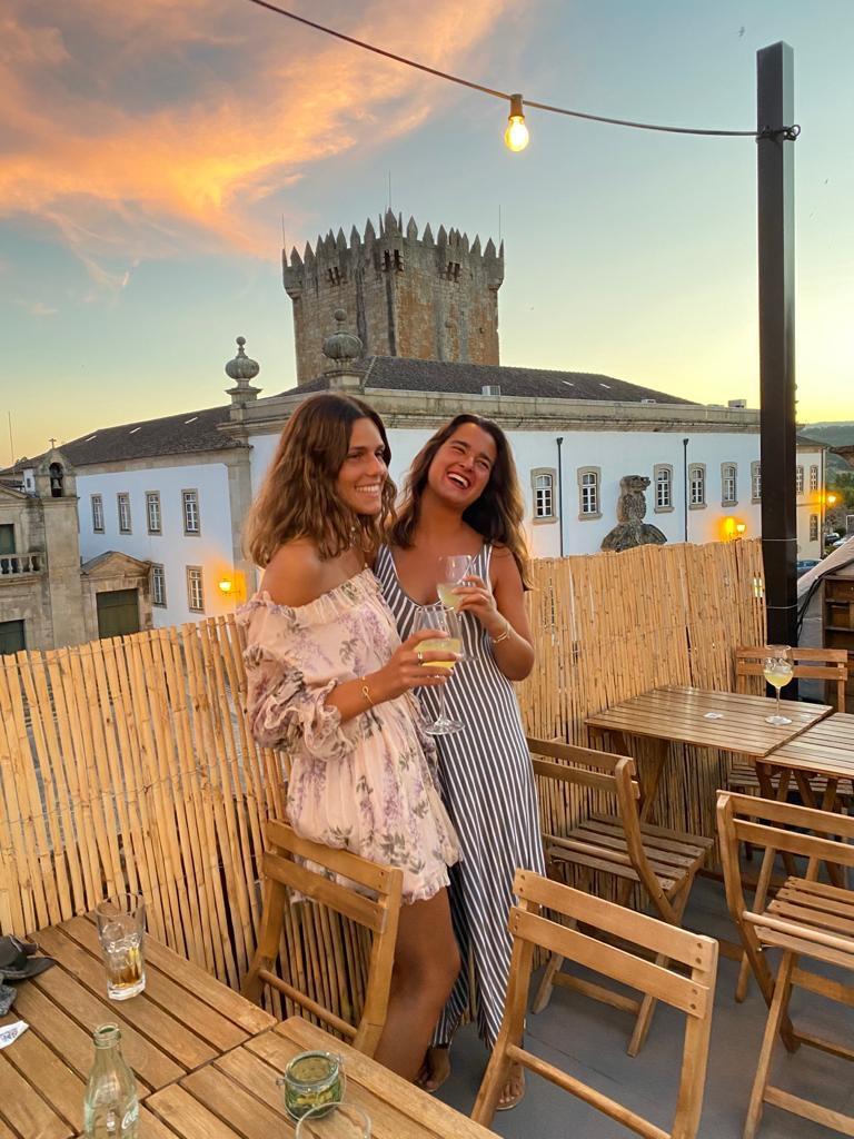 Girls having deinks at a rooftop bar
