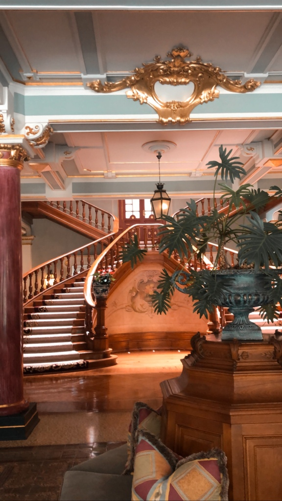Interior of Vidago Palace Hotel in Portugal. Wooden stairs